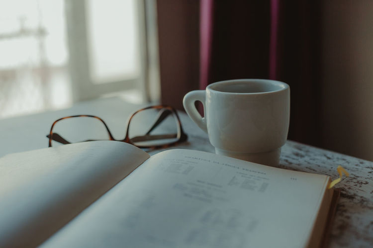 Coffee Coffee Break Coffee Time Studying Reading A Book Book Old Book French Vocabulary Education Learning Eyeglasses  Glasses Close-up No People Indoors  Drink Still Life Paper Cup Mug Publication Table Coffee Cup Coffee - Drink Food And Drink Refreshment Eyeglasses  Open Window Tea Cup