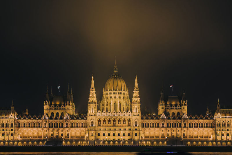 Illuminated hungarian parliament  against sky at night