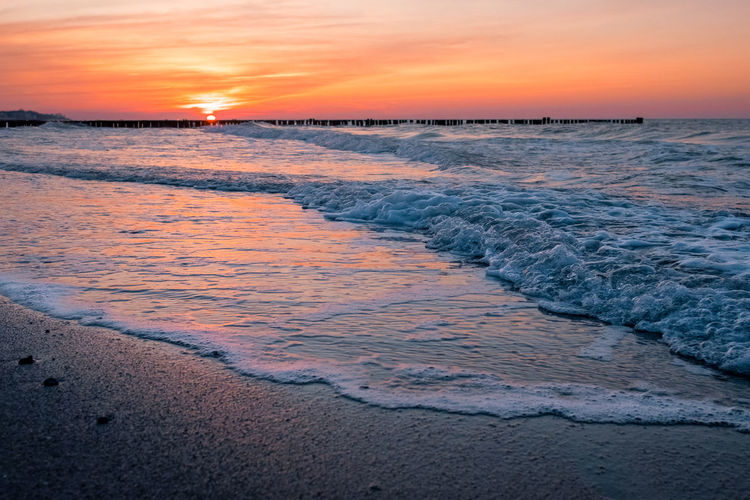 Baltic Sea Copy Space Freedom Romantic Twilight Beach Beauty In Nature Dusk Horizon Horizon Over Water Land Motion Nature Orange Color Outdoors Scenics - Nature Sea Sky Sunset Surface Level Surfing Tranquil Scene Tranquility Water Wave
