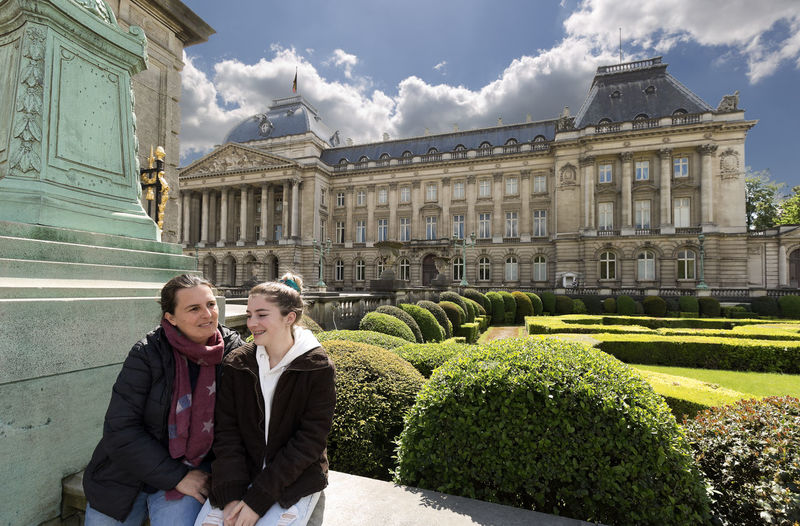 Mother and daughter next to the royal palace with its gardens in Brussels capital of Belgium. Belgium Brussels Place Travel Adult Architecture Bonding Building Exterior Built Structure Couple - Relationship Day Emotion Garden Gardens Nature Positive Emotion Real People Royal Palace Smiling Standing Three Quarter Length Travel Destinations Two People Women Young Women