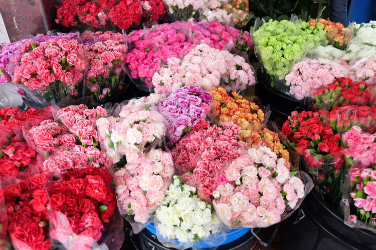 Various flowers in market for sale