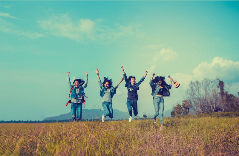 Group of Young Asian women jumping enjoy travel trekking to destination in vacation time for go to camping. Field Land Sky Group Of People Nature Grass Real People Women Child Casual Clothing Human Arm Togetherness Men Plant Lifestyles Day Emotion Leisure Activity People Arms Raised Positive Emotion