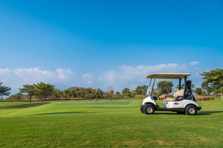 Golf Golf Course Grass Leisure Activity Green Color Plant Sky Golf Cart Field Green - Golf Course Land Day Sport Activity Nature Land Vehicle Tree Transportation Men Mode Of Transportation Outdoors
