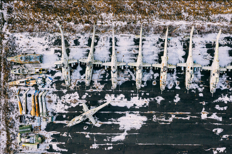 Aerial view of abandoned helicopters on land during winter