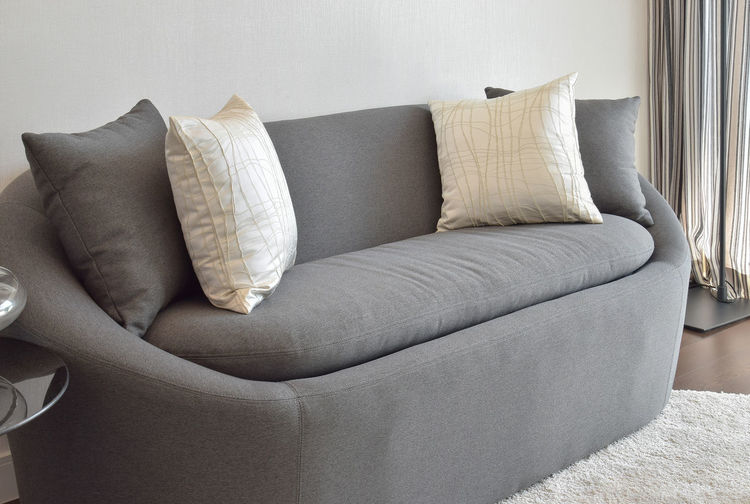 Full frame shot of sofa on bed at home