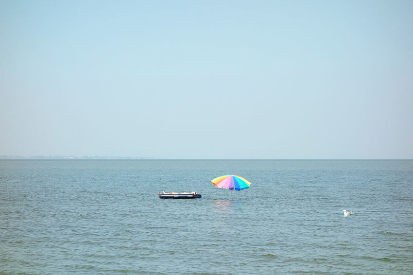 Chilling Sunbathing Blue Sky Calm Beach Holiday Tranquil Scene Floating On Water Floating