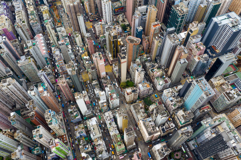 Top view of Hong Kong city Hong Kong Top View City Mong Kok Kowloon Side District Cityscape Road Traffic Sky Urban Office Capital Skyline Street Town Aerial Fly Drone  Over Above Down Top Down Bird Eye Hk Hong Kong Downtown Residential  Building Architecture