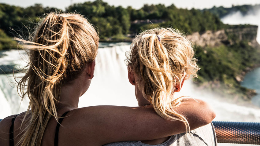 Adult Blond Hair Bonding Couple - Relationship Day Focus On Foreground Hair Hairstyle Headshot Human Hair Leisure Activity Lifestyles Long Hair Outdoors People Portrait Positive Emotion Real People Rear View Togetherness Two People Women Young Adult Young Women