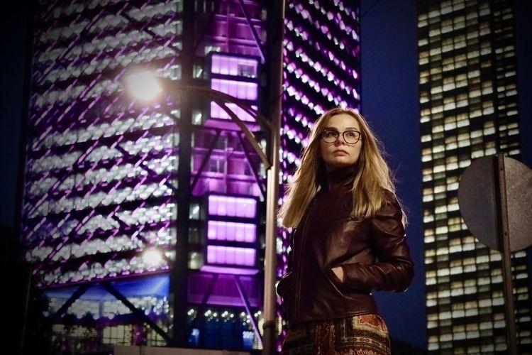 Female portrait, buildings at night