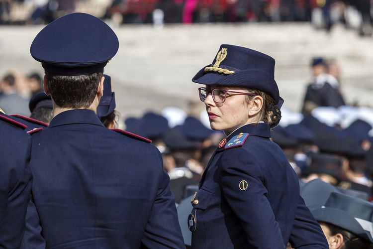 Rome, Italy - April 30, 2016: Policemen in uniform in St. Peter's Square, during the general audience of the Pope, on the occasion of the Jubilee of the armed forces. Blue Caps Commissioners From Behind Officers Police Policewoman Uniforms