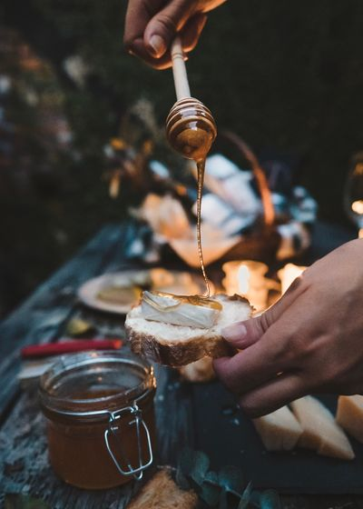 Pouring honey over cheese EyeEm Selects Human Hand Hand Human Body Part Holding Food And Drink Real People One Person Pouring Body Part Focus On Foreground Lifestyles Unrecognizable Person Food Human Finger Finger Human Limb