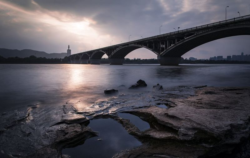 the riverside of the xiangjiang river Connection Architecture BridgeTravel Destinations Nature Arch City River Business Finance And Industry Cloud - Sky Beauty In Nature Arch Bridge Outdoors Mode Of Transportation No People Bridge - Man Made Structure Built Structure Water Transportation Sky