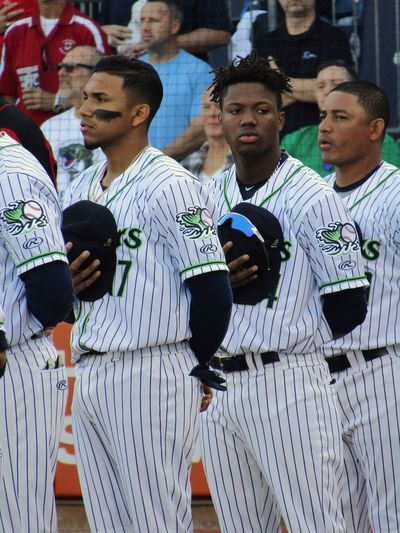 Johan Camargo and Ronald Acuña Jr stand for the National Anthem at Gwinnett Stripers home opener National Anthem Stripers Gwinnett Milb Baseball Real People Group Of People People Leisure Activity Day Men Standing