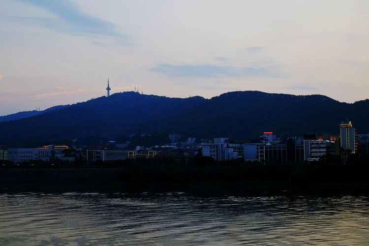 FUJIFILM X-T10 Mountain Water No People Outdoors Lake Night City Sky Cityscape Tranquil Scene Travel Destinations Changsha, Hunan Vacations Horizon Over Water Landscape Reflection Tranquility Water Reflection Light And Shadow Sunset And Clouds  Cloud - Sky Beauty In Nature Urban Skyline Skyscraper