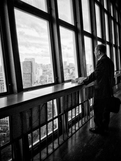 People looking through modern building