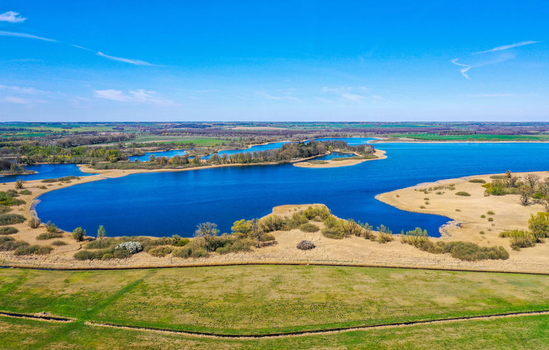 Aerial view of meadows and a lake Lake Meadows Agricultural Field Suuny Day Springtime Spring Teterow Countryside Shore Scenics Tranquil Scene Idyllic Beach Ocean Wave Sandy Beach Pebble Beach Horizon Over Water Coast Grassland