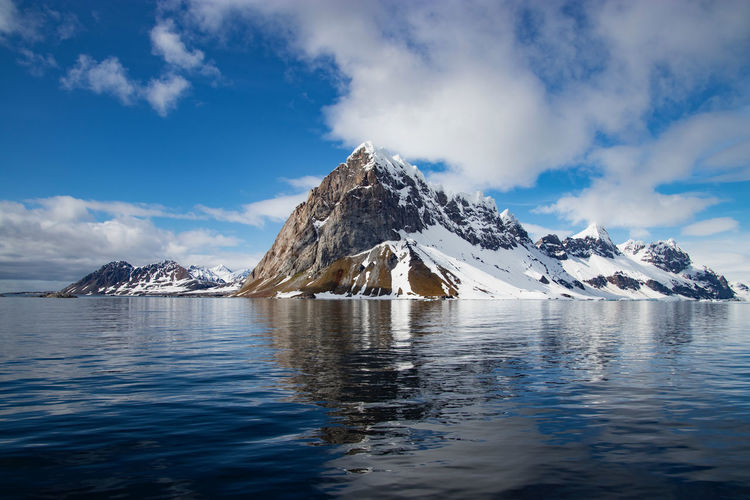 Beautiful reflections in a bay in Svalbard in the Arctic Mountain's Reflection Svalbard  Spitsbergen Sky And Clouds Snow Capped Mountains Sky Cold Temperature Landscape Winter Arctic