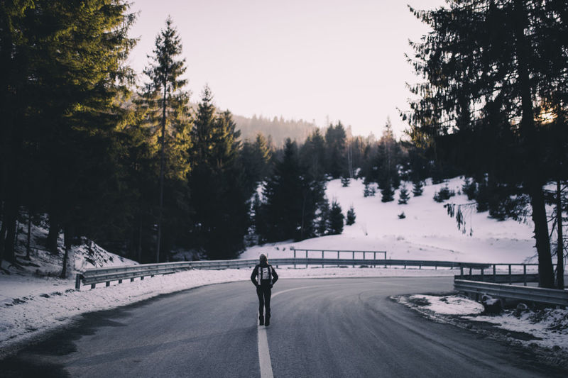 Man on snow covered road