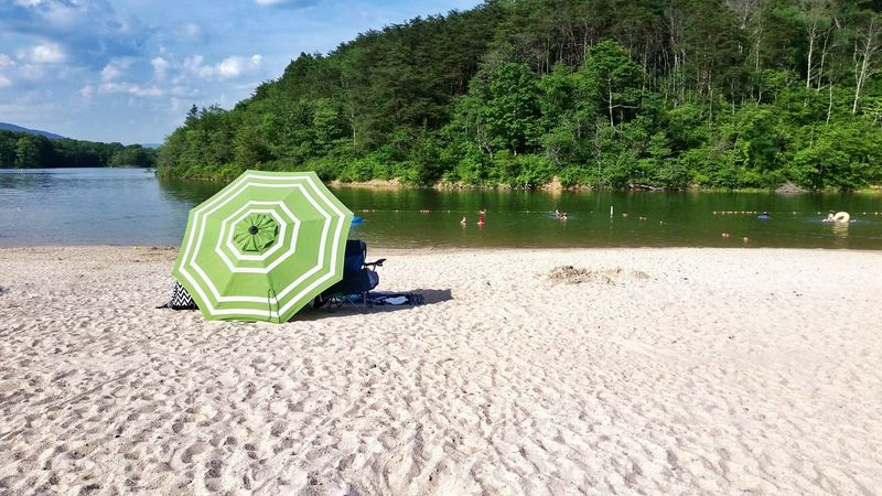 Green umbrella on sand beach in summer Day Outdoors Nature Sky Umbrella People In The Distance People In The Water Summer Travel Destinations Lake Habeeb Swimming Sunning Shade Refreshment Sand Sand Beach The EyeEm Collection The Photojournalist - 2017 EyeEm Awards Sommergefühle 100 Days Of Summer The Premium Collection Summer Exploratorium