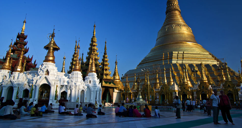 Shwedagon Pagoda Tourist Attraction  World Heritage Yangon, Myanmar Architecture Buddhism Buddhist Temple Building Exterior Built Structure Gold Colored Large Group Of People Outdoors People Place Of Worship Real People Religion Spirituality Travel Destinations