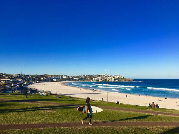 Bondi Beach Sydney, Australia Sea Beach Clear Sky Blue Leisure Activity Nature Copy Space Water Scenics Day Men Real People Grass Outdoors Sand Vacations Sport Beauty In Nature Lifestyles Full Length