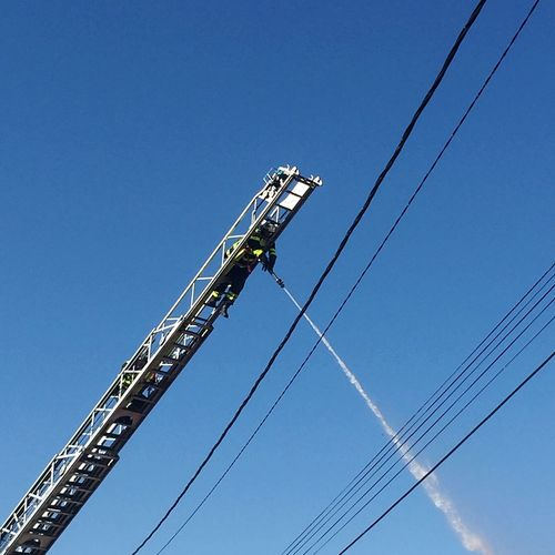 Fireman 🔥 Burn Burning Thankyou Fireman Working Job Sky Low Angle View Sky Clear Sky Cable Blue Nature Metal Outdoors RISK Day Real People Tall - High