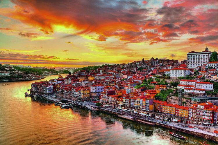 Perspectives from Porto. Water Cloud - Sky Sky Architecture Built Structure Building Exterior Sunset Orange Color Nautical Vessel Waterfront Nature City Transportation Building No People Residential District Reflection Harbor Mode Of Transportation Outdoors Cityscape Canal TOWNSCAPE Colors Houses