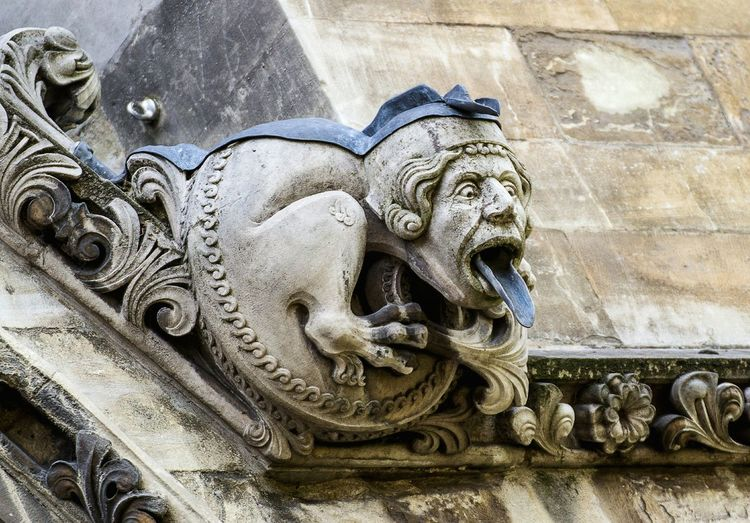 Low angle view of gargoyle sculpture on westminster abbey