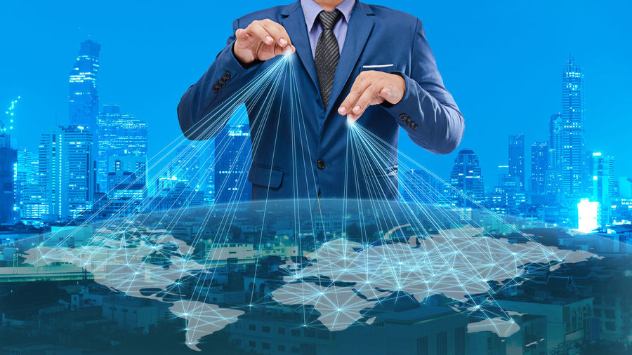 Digital composite image of businessman and world map
