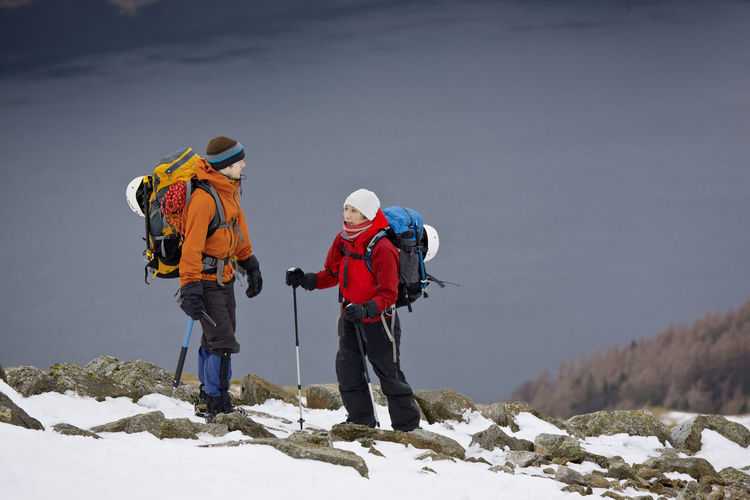 People standing on snow covered mountain