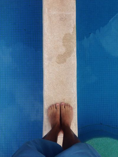 Low section of man over swimming pool