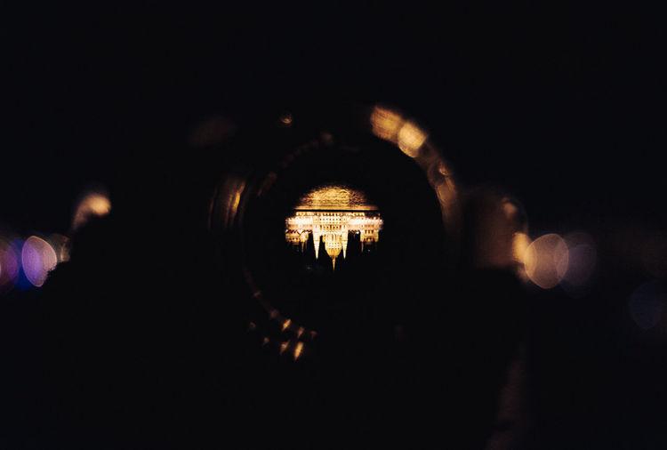 Silhouette people on illuminated stage at night