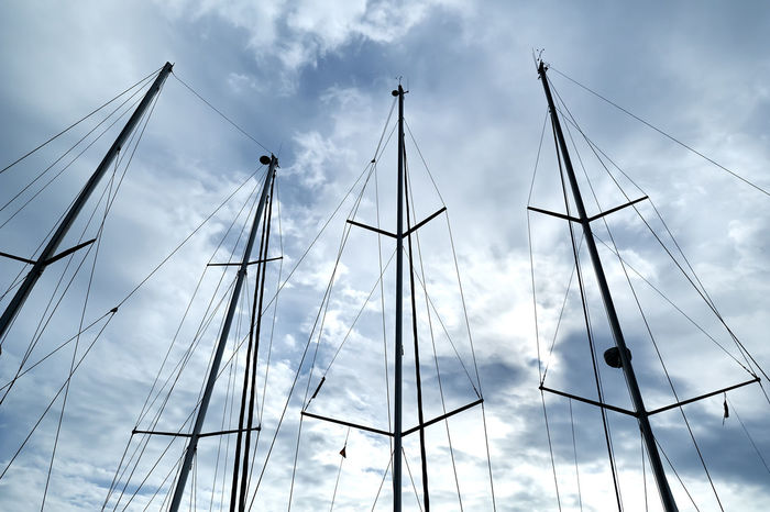 Ship masts over blue cloudy sky background Marina Sailing Ship Yachts Boat Cloud - Sky Clouds And Sky Day In A Row Mast Mode Of Transportation Nautical Vessel No People Nobody Outdoors Port Rigging Sailboat Sailboats Ship Silhouette Sky Transportation Vessel Yacht Yachting