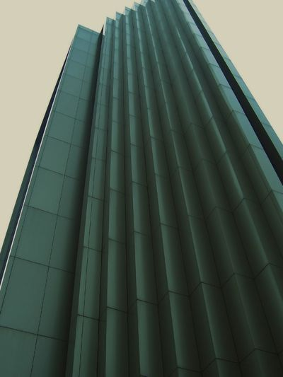 Tall modern building Architecture Business Geometric Shapes Steel Technology Texture Pattern Construction Corners Corporation Design Façade Perspective Urban Skyscraper Wall Mosaic City High Exterior Future