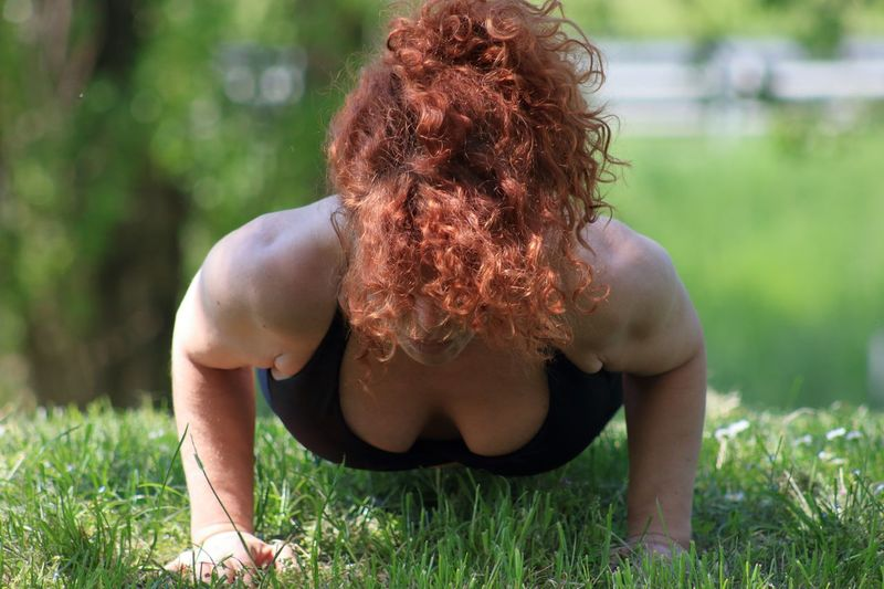 Woman Exercising On Field