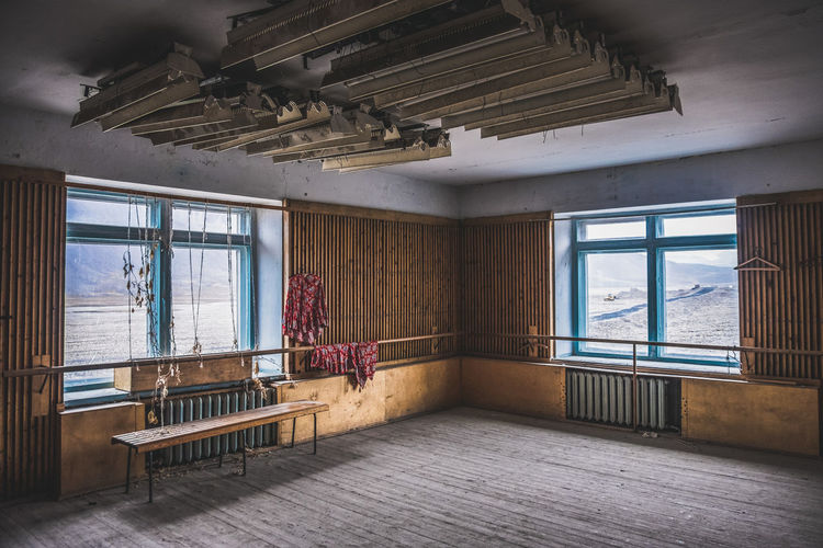 Abandoned gym in the arctic ghost town of pyramiden, svalbard