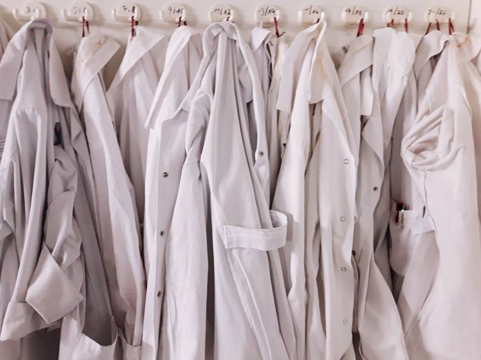 Full frame shot of lab coats hanging at laboratory