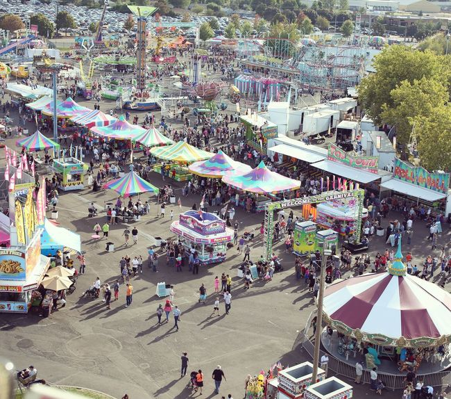 State fair. State Fair Fair Fair Rides Crowded Crowded People Crowded Place High Angle View Day Outdoors Leisure Activity Lifestyles