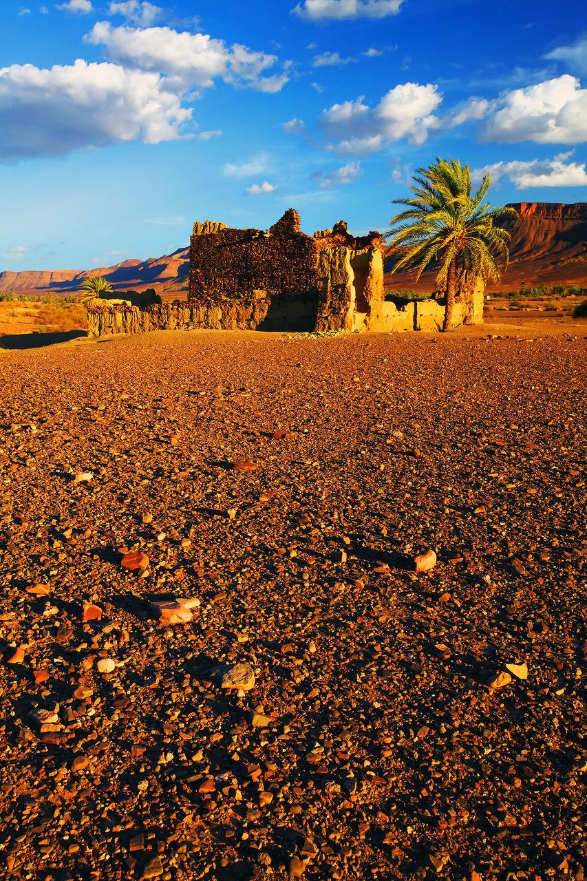 Old Ruin In Desert Against Cloudy Sky