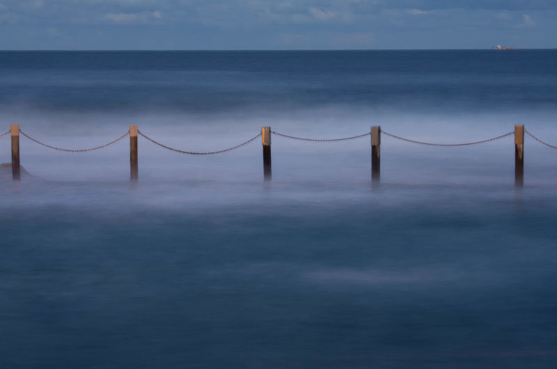 Beach Beauty In Nature Blue Built Structure Connection Day Horizon Horizon Over Water Idyllic Land Nature No People Outdoors Scenics - Nature Sea Sky Tranquil Scene Tranquility Water