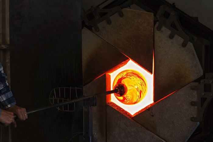 Glass Art Burning Day Factory Filling Flame Foundry Glass Glass - Material Glass-blower Glowing Heat - Temperature Holding Indoors  Industry Manual Worker Men Molten Occupation One Person Orange Color People Real People Working Business Stories