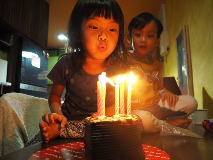 Birthday celebrations. Blowing candles Child Two People Childhood Candle Females Girls Cake Birthday Indoors  Burning Fire Flame Food Birthday Cake Women Sweet Sweet Food Food And Drink Togetherness Celebration Moments Of Happiness