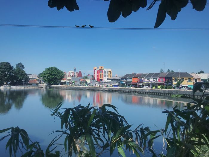 My small city pamulang Water Sky Building Exterior Built Structure Architecture Reflection Nature No People Outdoors Lake City Clear Sky Plant Waterfront Blue Tree Building Day