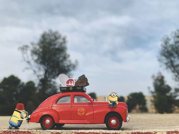 Toy car on road against sky