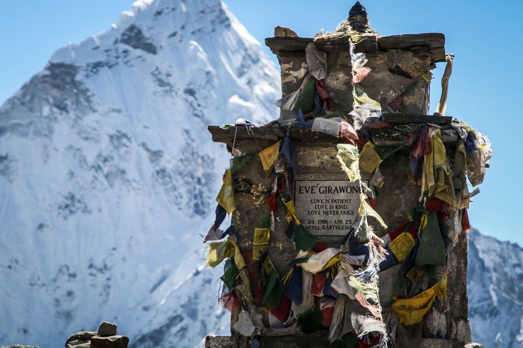 Panoramic view of clothes hanging on mountain against sky