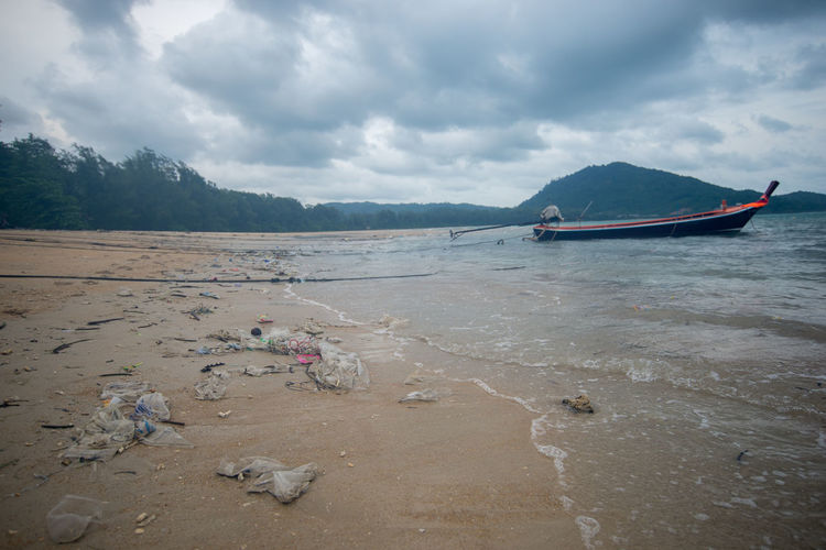 Cloud - Sky Water Sky Nature Beach Tranquility Land Day Nautical Vessel Beauty In Nature Tranquil Scene Transportation Environment Sea Scenics - Nature Mode Of Transportation Mountain Sand Outdoors No People SHELLFISH  Bottle Bottle Cap Bottles Collection