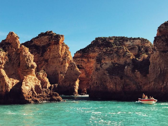 Ponta Da Piedade Algarve Sea Blue Scenics Tranquility Nature Rock Formation Clear Sky Tranquil Scene Beauty In Nature Water Waterfront Rock - Object Cliff Idyllic Day Nautical Vessel Travel Destinations Outdoors No People Sailing