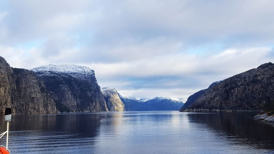 peace and relaxation in beautiful lysefjord Fjord Fjordsofnorway Snowcapped Mountain EyeEm Selects Water Lake Nature Ice Mountain Winter Snow Beauty In Nature Cold Temperature Cloud - Sky Outdoors Day Scenics