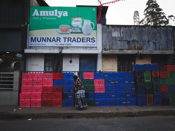 India Munnar Munnar India Munnar Kerala Munnar Top Station Walking Around Colourful Crates Crates India Street Indian Man Walking In The Par Kerala Kerala India Outdoors Stacked Crates Street Photography Street Photography India Street Scenes Of India
