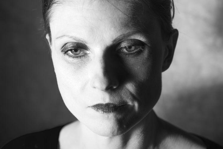 Close-up portrait of mid adult woman